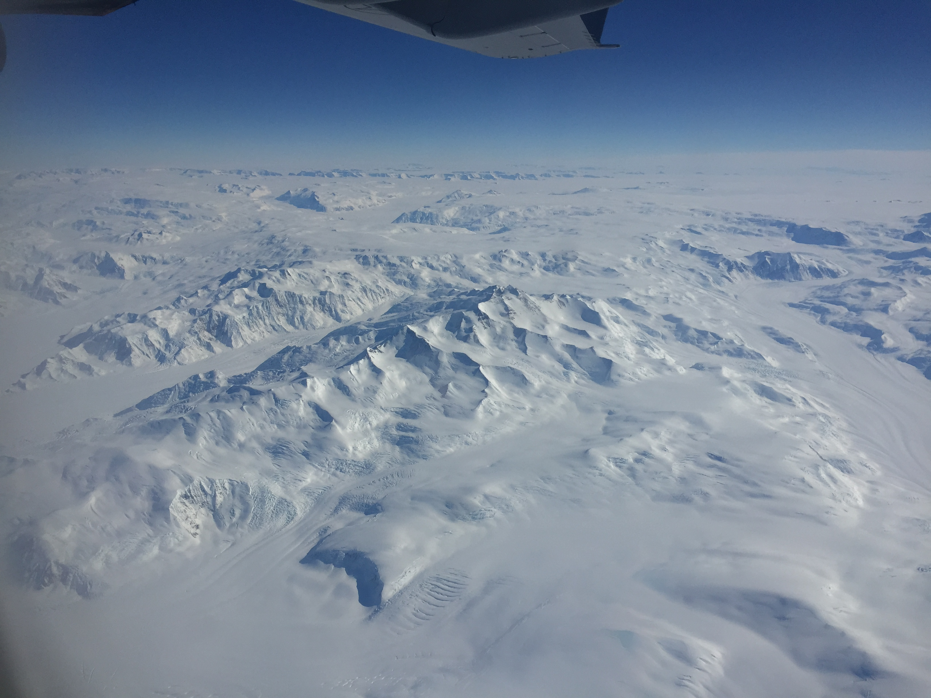 Pretty epic views on the way there. It's difficult to tell the scale of the mountains in the left photo given how much snow has pilled up. On the right, you can see what I think is a bit of the unfrozen ocean.
